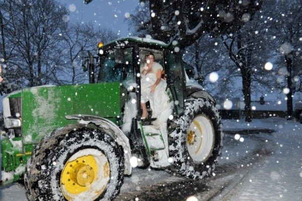 Bride in snow on tractor