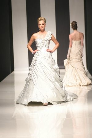bridal gown with shoulder ruffle