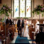 bride-and-groom-walk-down-aisle-of-country-church