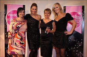 Paula from Nicole Photography winning her Wedding Ideas Award