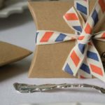 wedding-in-a-teacup-Set-Of-10-Brown-Kraft-Pillow-Boxes-£3.50-Par-avion-ribbon-£9