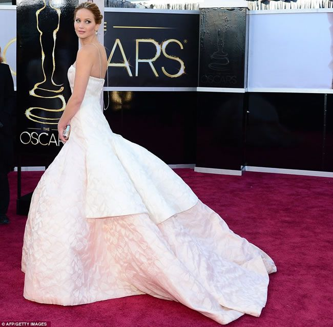 Oops! Jennifer Lawrence takes a tumble in bridal-inspired Oscars gown