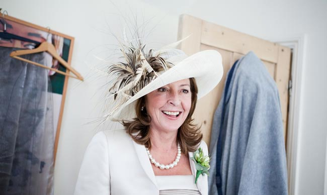 Lady wearing hat - The 12 Golden Rules of Wedding hat Etiquette