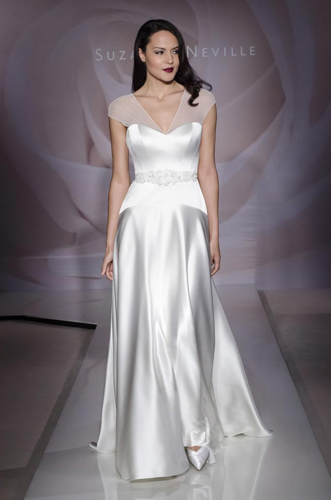 Wedding dress: Charmed By Suzanne Neville