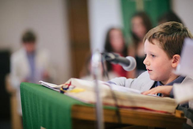 Young boy doing a wedding reading Four of the Best Wedding Readings for Children
