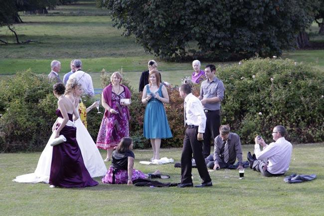 do-you-need-entertain-guests-wedding-talking-on-grass-jamesbiggs.com