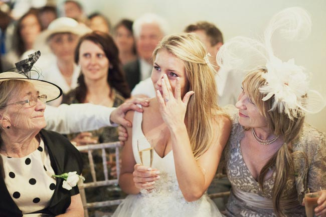 bride crying at wedding with guests The Most Popular Wedding Readings for Modern Ceremonies