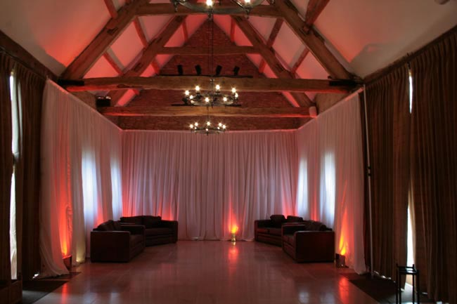 9-budget-friendly-ways-style-wedding-reception-venue-freestanding drapes2
