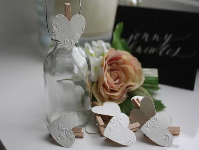 8-little-wedding-buys-that-will-make-a-big-impact-on-the-day-MINI_PEGS_www.biglittlethings.co.uk_flowerembossedpegs_2.50