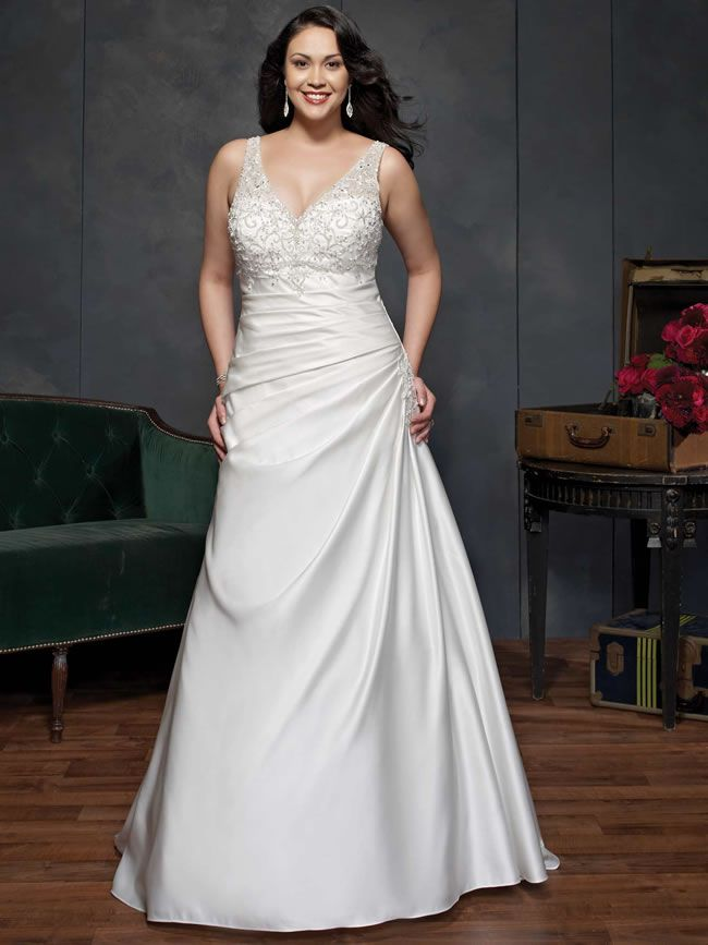 Plus-size brides will love the amazing new Femme by Kenneth Winston collection for 2014
