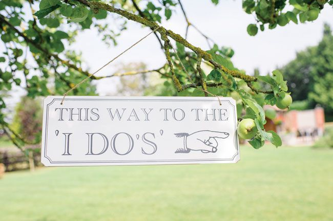 7-of-the-best-new-wedding-signs-and-sayings-for-2014-This-way-to-the-I-Dos-Sign-6.50-The-Wedding-of-my-Dreams--Credit-Daffodil-Waves-Photography-(136)