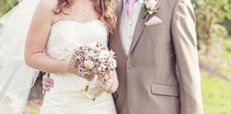 Jayne and Neil's vintage-inspired day was full of paper flowers and pretty pinks © Katy Melling
