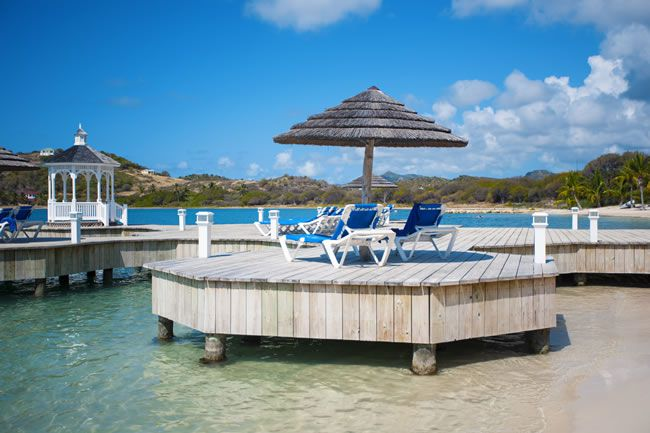 4-fabulous-honeymoon-hotspots-in-antigua-StJamesClubandVillasMamoraBaySunLoungersonPier