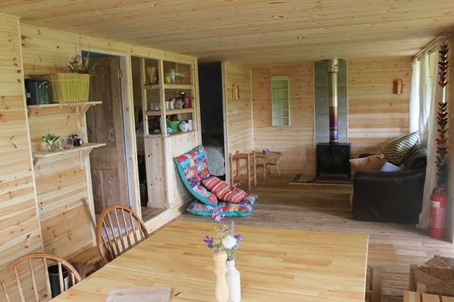 8-glamping-hen-parties-for-the-boho-bride-to-be-Damson-Cabin-Living-Room-2