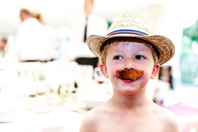 Child with hat and moustache - Should you Take Your Children on Honeymoon With you?