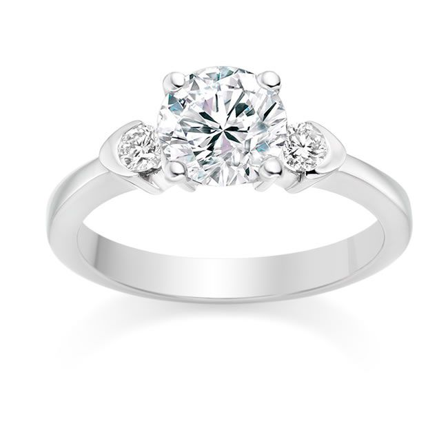 what-makes-him-propose-Round Cut 0.66 Carat Three Stone Engagement Ring in Platinum - £2,312