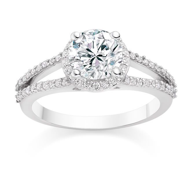 what-makes-him-propose-Round Cut 0.74 Carat Halo Engagement Ring with Side Stones in Platinum - £3,067