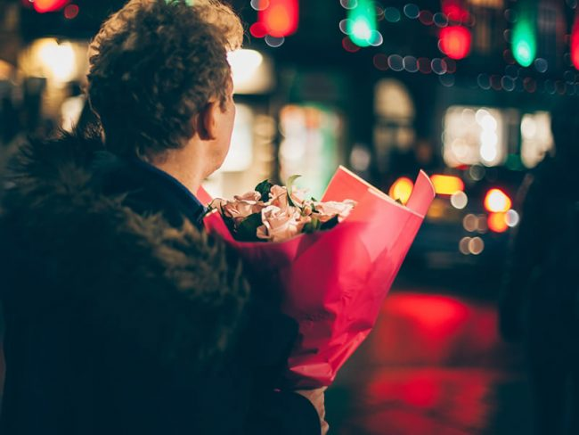 Man holding a bouquet for 5 Reasons To Propose This Christmas!