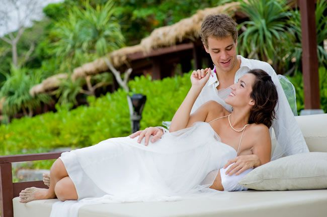 marry-abroad-Wedding Couple on Daybed on beach