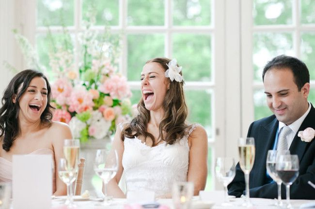 Bride laughing - What Your Bride Wants to Hear in Your Groom's Speech