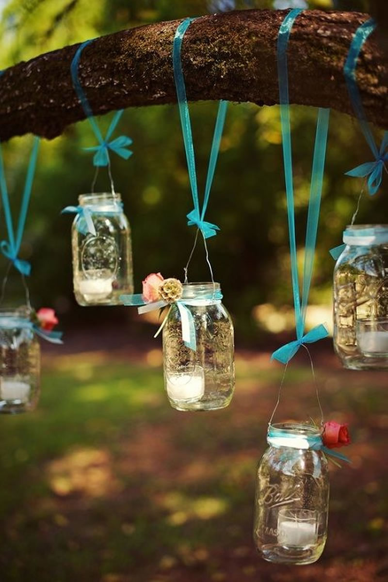 9-reception-decorations-summer-wedding-candles via Pinterest http://www.weddingchicks.com/gallery/rustic-outdoor-wedding/?nggpage=2&pid=14319