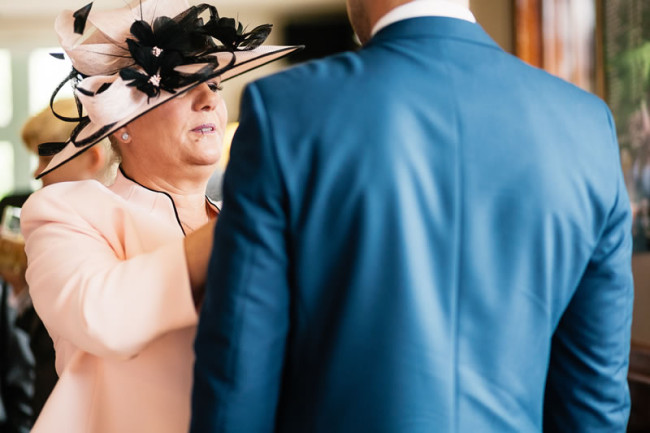 Lady wearing hat with man- The 12 Golden Rules of Wedding hat Etiquette