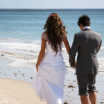 things-couples-forget-getting-married-abroad-Wedding Couple walking in sand