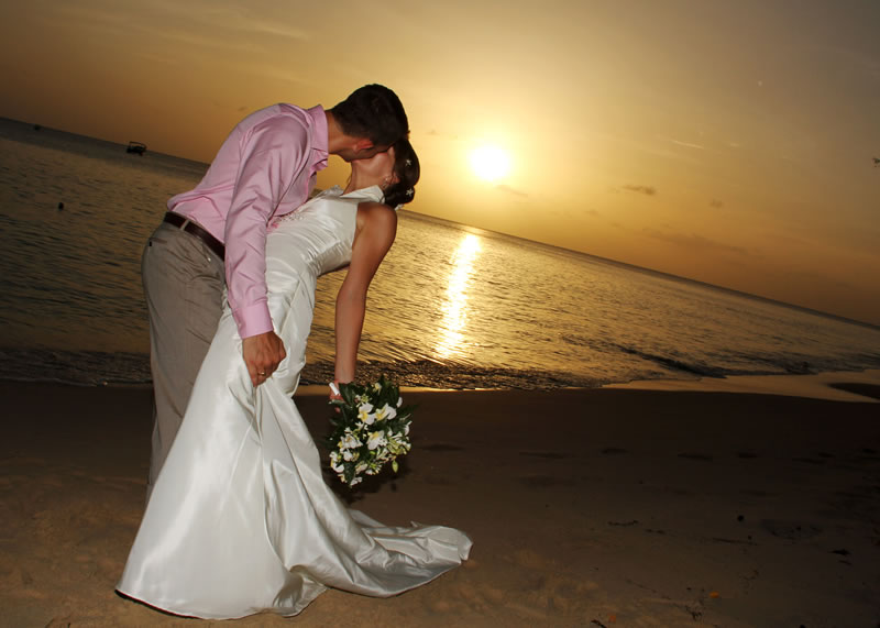 elegant-hotels-Wedding couple on the beach at sunset