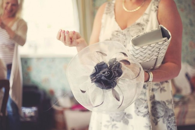 Lady holding hat - The 12 Golden Rules of Wedding hat Etiquette