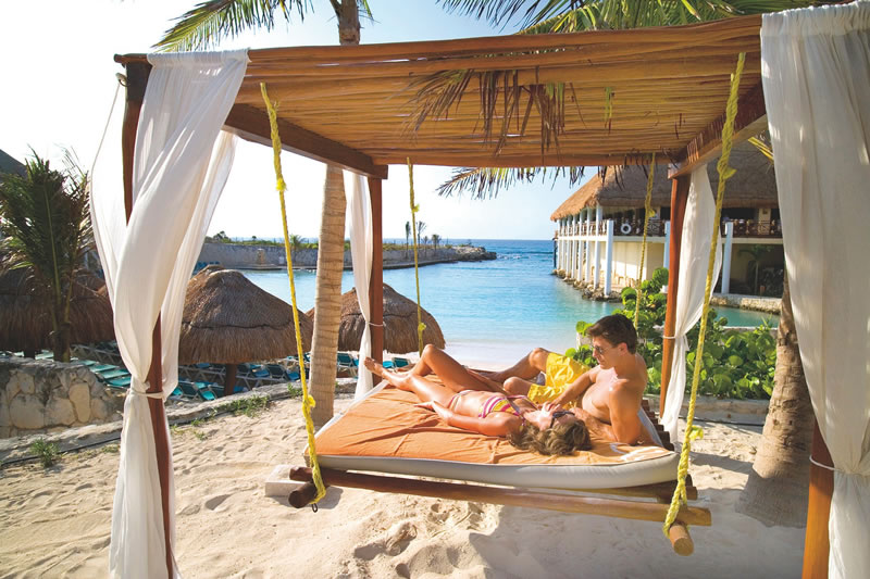 dream-honeymoons-1k-Couple on hammock on beach at Occidental Grand Xcaret Mexico