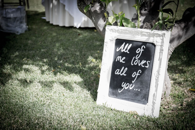 'all of me loves all of you' sign Gemma and Paul had the Prettiest Mint Green Wedding