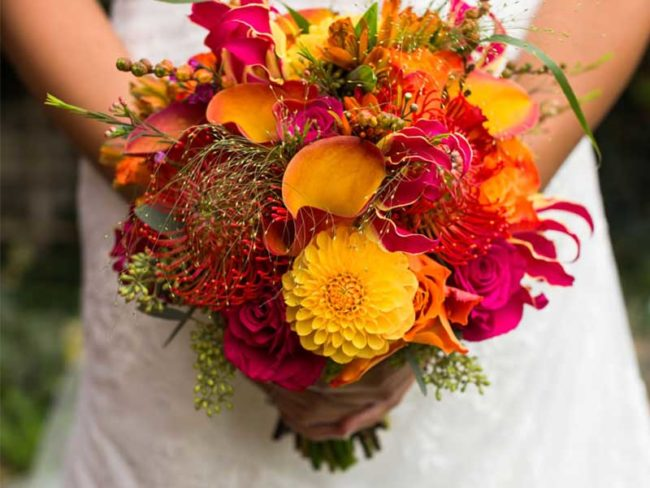 orange and red bouquet Natalie and Simons wedding bonfire night