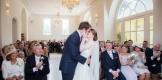 Blooms and nude tones for Lauren and James's real wedding