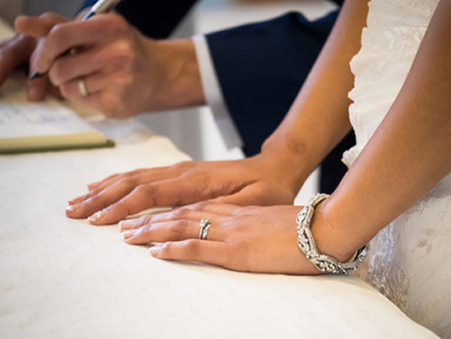 signing the register Six Things To Do After Getting Engaged