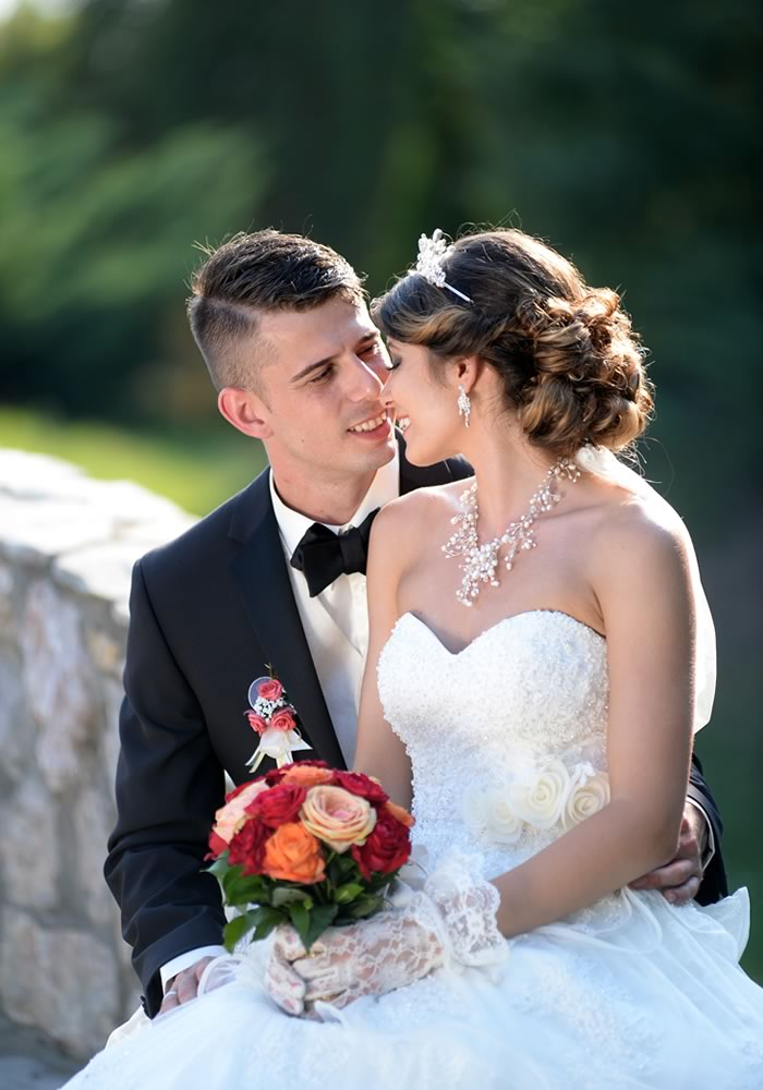 Dejan and Natali's Shakespearean love story with a romantic proposal on Juliet's balcony and a red, gold and white Renaissance wedding theme!