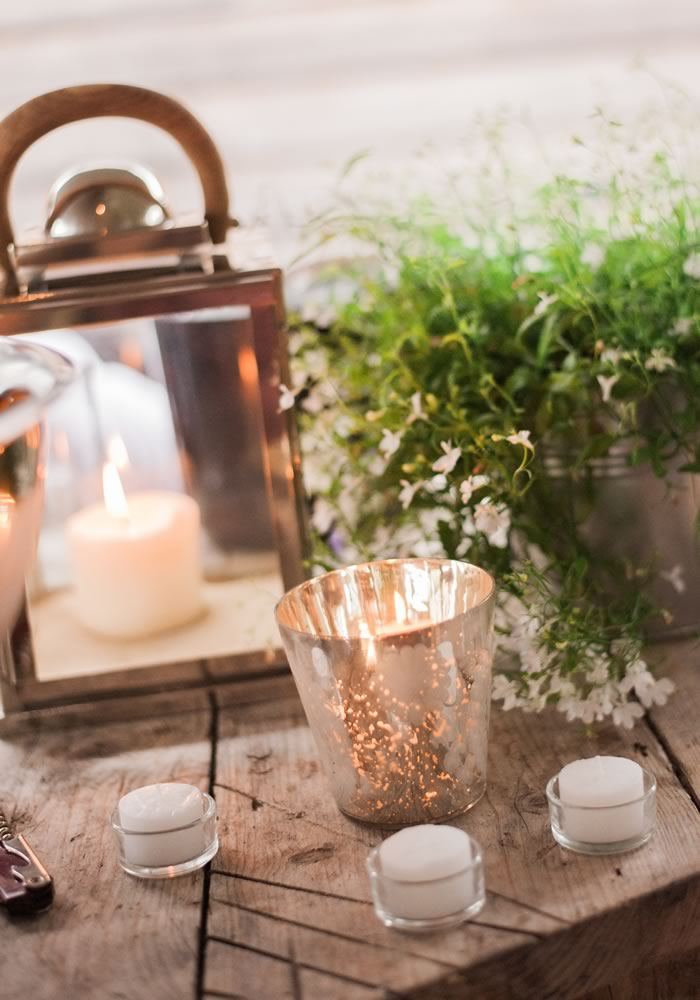 A barn wedding for Katie and Simon filled with twinkling candles and glittering gold accents for an amazingly atmospheric wedding day! Click for more real life photos and inspiration for your flowers, cake, wedding reception decor and more on the Wedding Ideas website!
