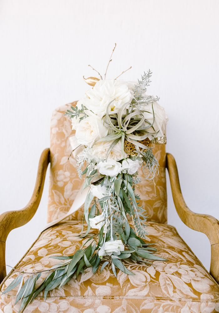 Be inspired by Nicci and Vaughn's boho-chic big day, where all things rustic are enhanced with sparkles and touches of opulent gold