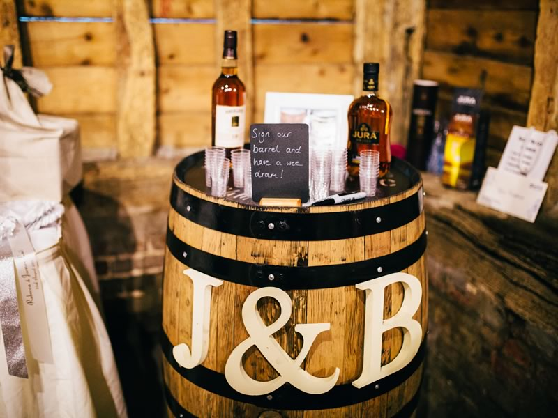 Becca and James marry in a twinkling barn wedding ceremony with Scottish touches - think whisky barrel guest books and Scottish tablet favours!