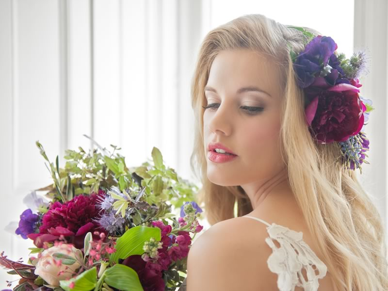 Behind the scenes of our new August issue's cover shoot, featuring romantic tones of deep purple and red, floral hair accessories and stunning dresses. See more from the shoot on the Wedding Ideas website!