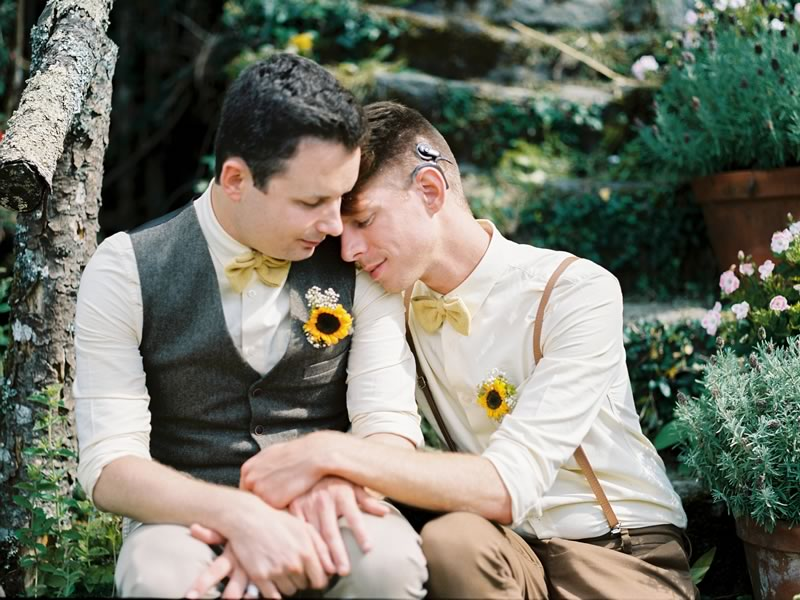 Sam and Matthew celebrate saying 'I do' with a travel theme for their big day, featuring suitcases, postcards and an abundance of sunflowers! See more photos on the Wedding Ideas website and be inspired for your big day!