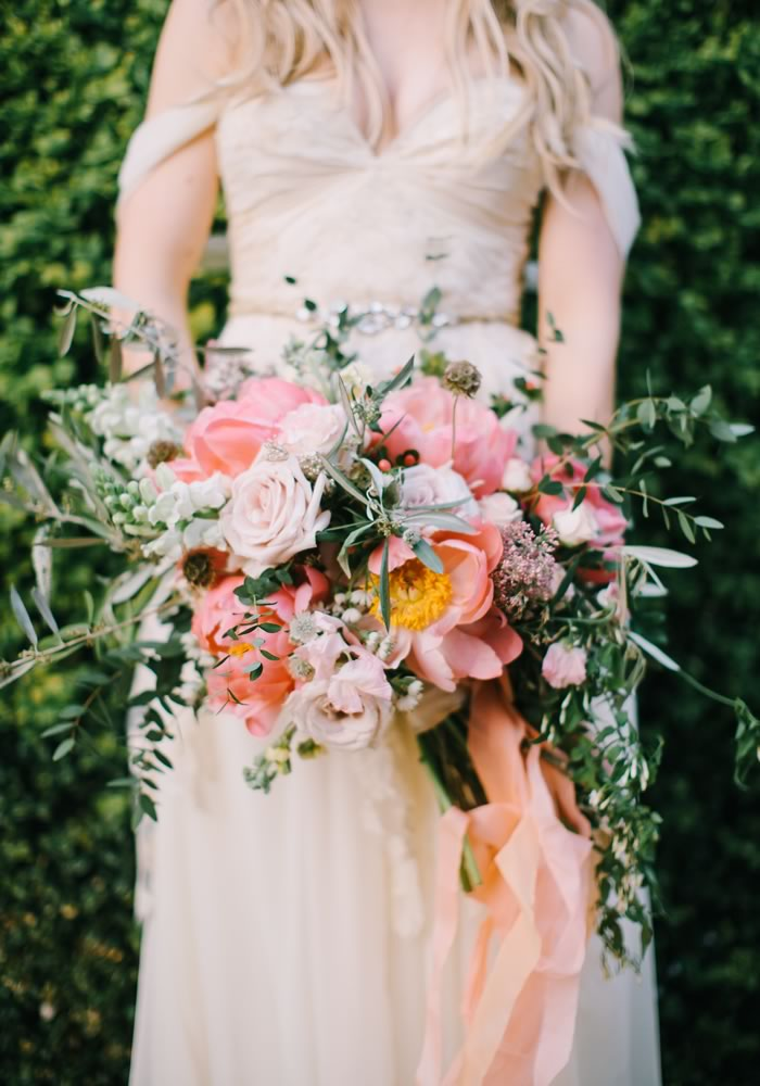 21 swoon-worthy bridal bouquets for you and your maids! Whether you want trailing florals, traditional roses or pretty peonies, here's all the inspiration you need for beautiful wedding flowers!