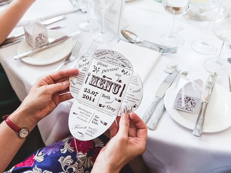 You decorate your reception tables and pick your flowers with precision, let your wedding menu designs live up to their lovely surroundings with these ideas