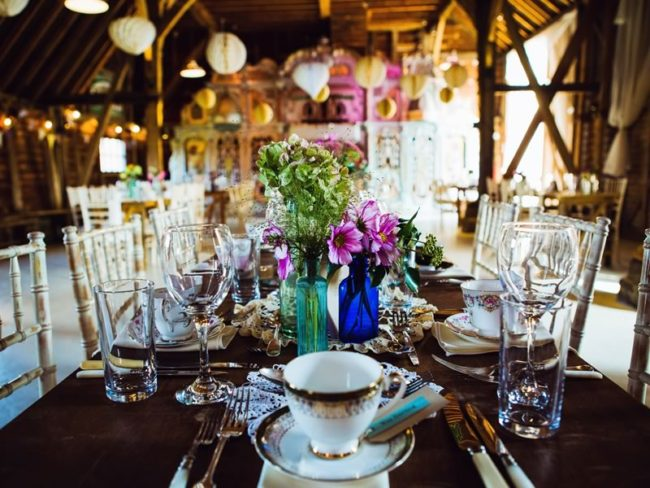Here's exactly how to create the most beautiful boho brights reception theme just like this couple did and give your barn venue some serious style!