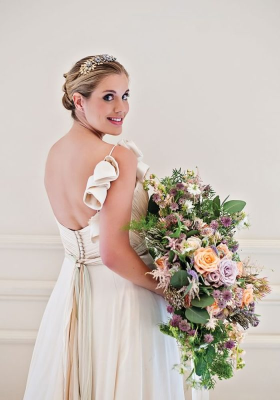 Fall in love with the inspirational dresses, styling, decor, flowers and venue in this fairytale, feminine Four Seasons photo shoot!