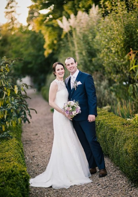 This rustic walled garden wedding is sure to steal your heart - here we share all the details, decor and dress inspiration from Sigrid & Daniel's big day!