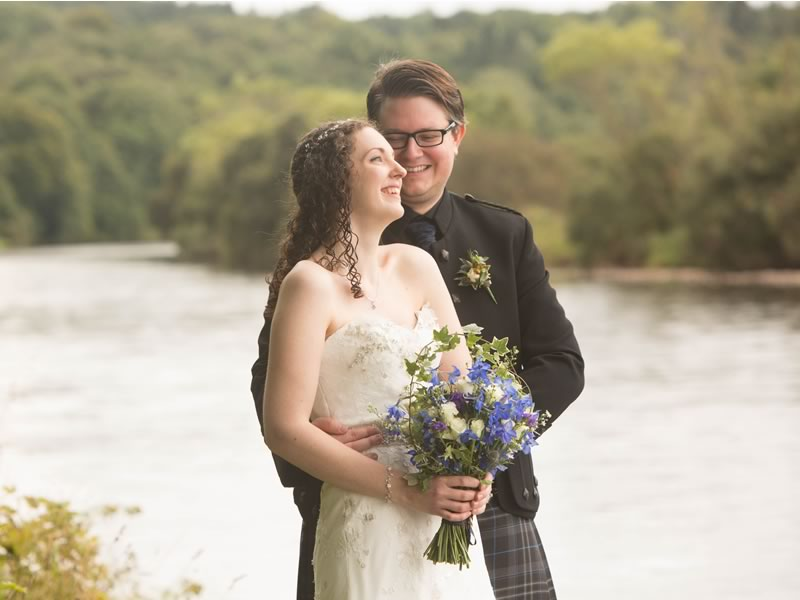 This lake wedding has it all! Stunning scenery, vibrant indigo flowers, and even the couple's dog looking smart in a suit - you'll LOVE it!