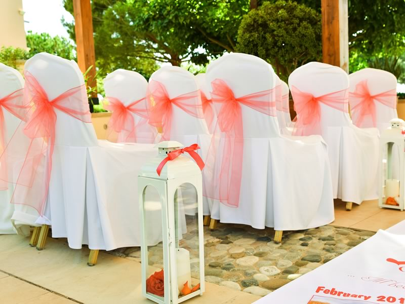 A cream and coral wedding in the sunny and stunning destination of Cyprus! Airy drapes, feminine flowers, a dream dress - be inspired by this real wedding!