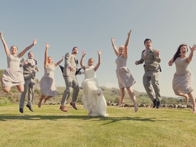While there is a place for staged shots that look exactly that, we think it's time for a modern, more fun approach to group photographs for today's couples