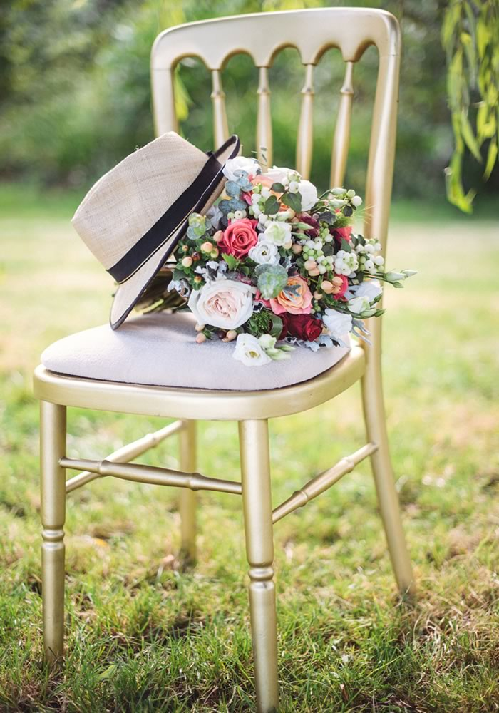 chair and flowers - Barn Wedding Decor and how to Style It