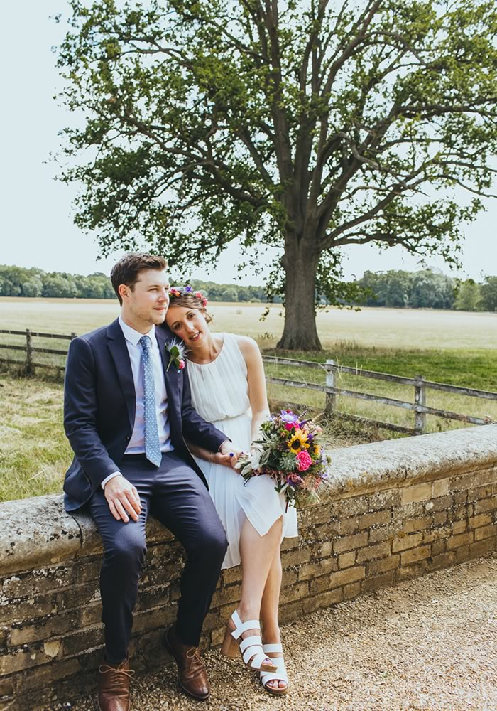just married sitting on wall Barn Wedding Decor and how to Style It